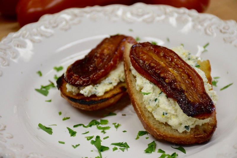 Backyard Farms Roasted Tomato and Herbed Ricotta Crostini