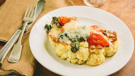 "Cauliflower ""Steak"" with Backyard Farms Cocktail Tomatoes"